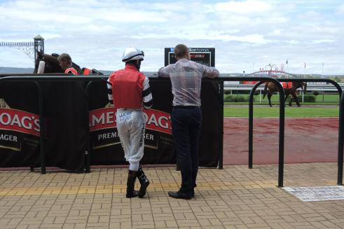 Last minute directions from trainer to jockey
